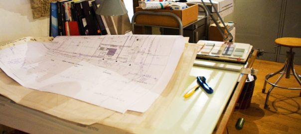 Desk of an architect with architectural plans