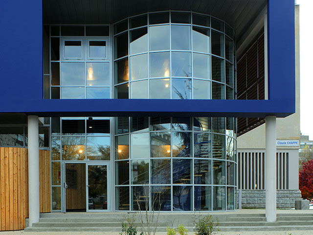 Building entrance with large glass wall