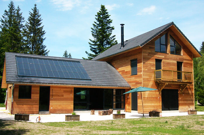 House with slate-covered roof and solar panels