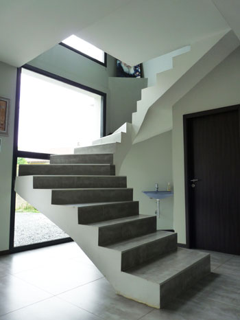 Modern stairs in front of a large window
