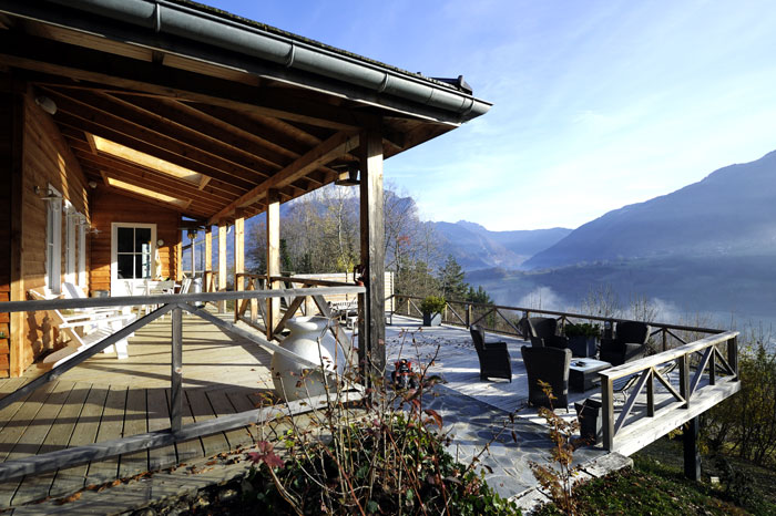 Wooden terraces overlooking a mountain panorama