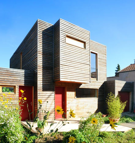 Wood frame house with cubic shapes