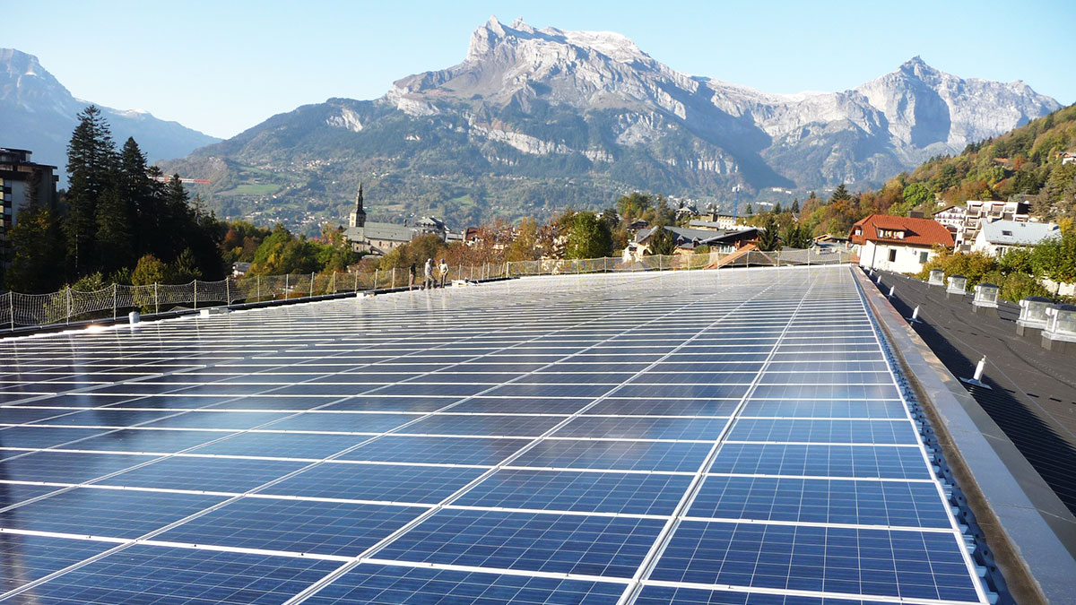 Photovoltaic pannels on the roof of a building in the mountains